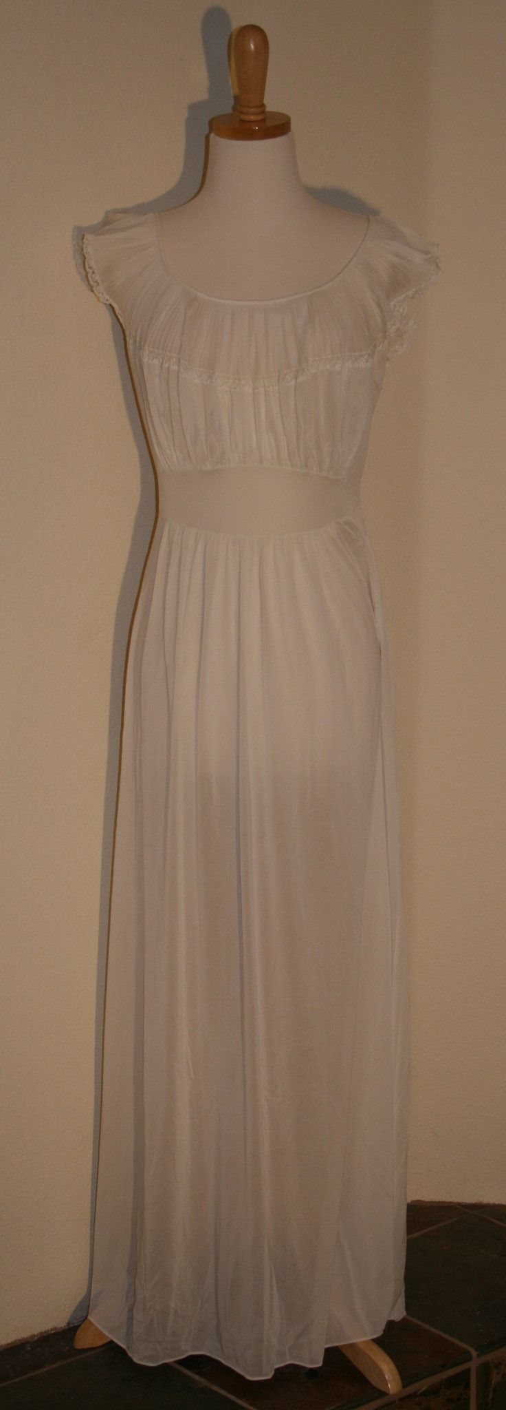 Slinky, sweet, classic design with tiny pleating across the decolletage…