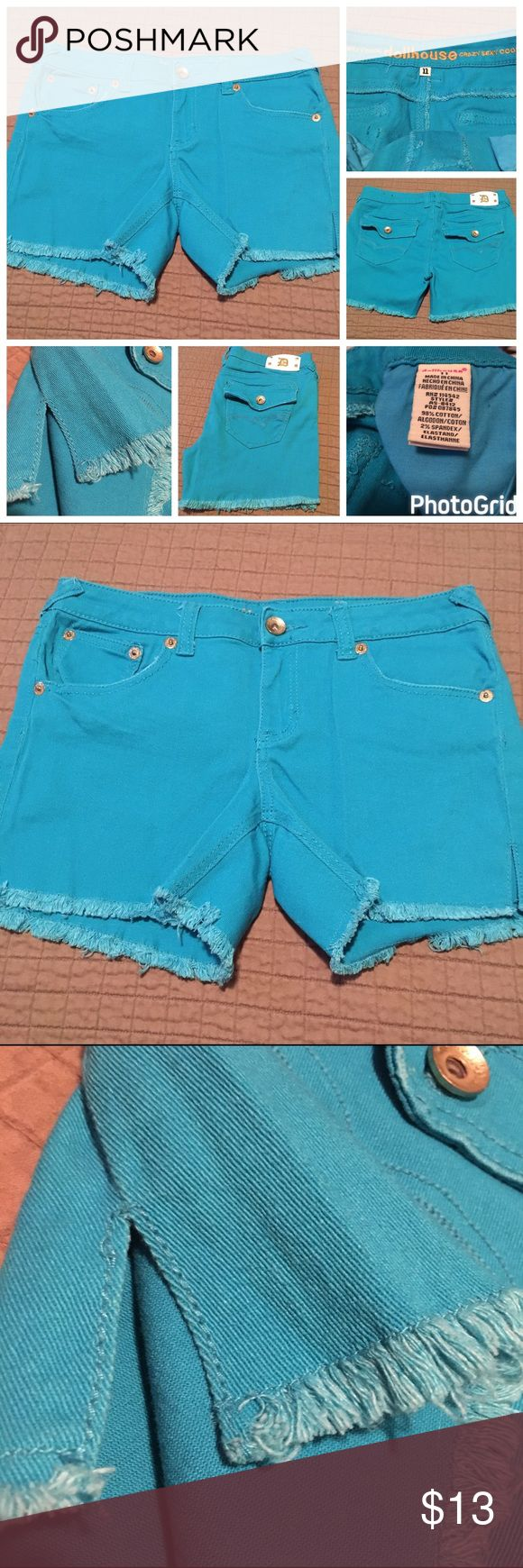 """Dollhouse Cutoff Jean Shorts NWOT SZ 11 Turquoise Dollhouse Cutoff Jean Shorts NWOT SZ 11 in Turquoise. Waist measures approximately 17"""" unstretched up  to approximately 18 1/2"""". Inseam is 4"""" & a rise of approximately 8 1/2"""". Back flap pockets, factory frayed hems & small side slits on legs. Never worn or washed!! Dollhouse Shorts Jean Shorts"""