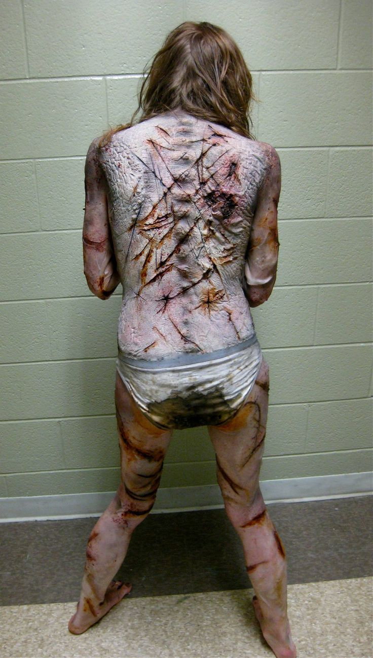 """Special Makeup Effects designed and created by The Butcher Shop for the short film """"Fodder"""". Written and Directed by David Dollard from Another Dollard Productions. Full body prosthetics consisting of a Foam latex face, chest and back appliances. With twelve plus, large and small wrap around bondo transfers coving her arms, hands, legs and feet. With contact lenses and dentures."""