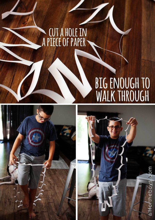 Cut a hole in a piece of a paper big enough to walk through.
