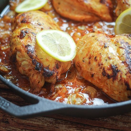 A delicious recipe for South African Piri-Piri chicken, featuring tender chicken breasts simmered in a spiced lemon and onion sauce. Easy and different!