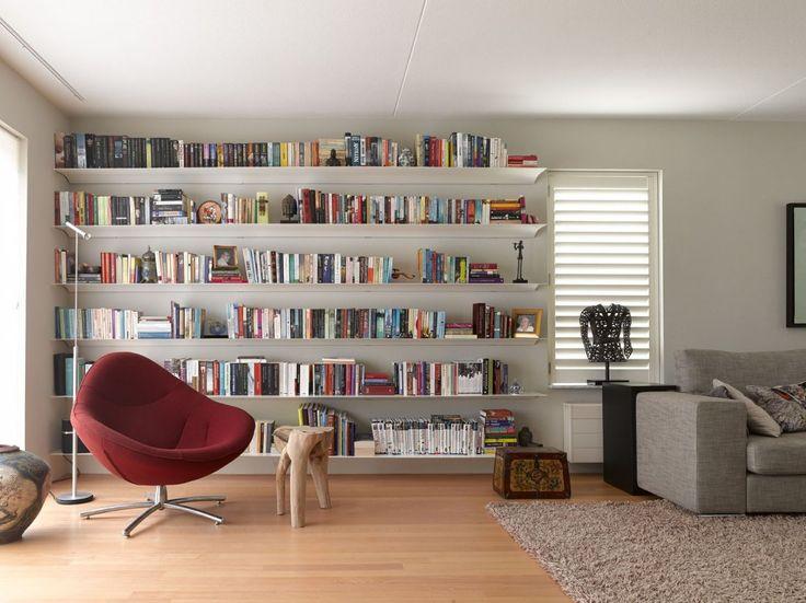 Plant Ideeen Woonkamer : Woonkamer met grote boekenwand Woonkamer ...