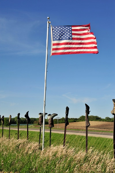 Country way of life.  Old boots on fence posts is a tradition in the Sandhills