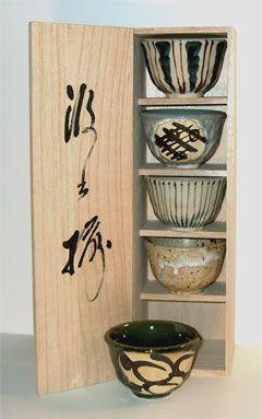 Japanese tea cups in miniature cabinet