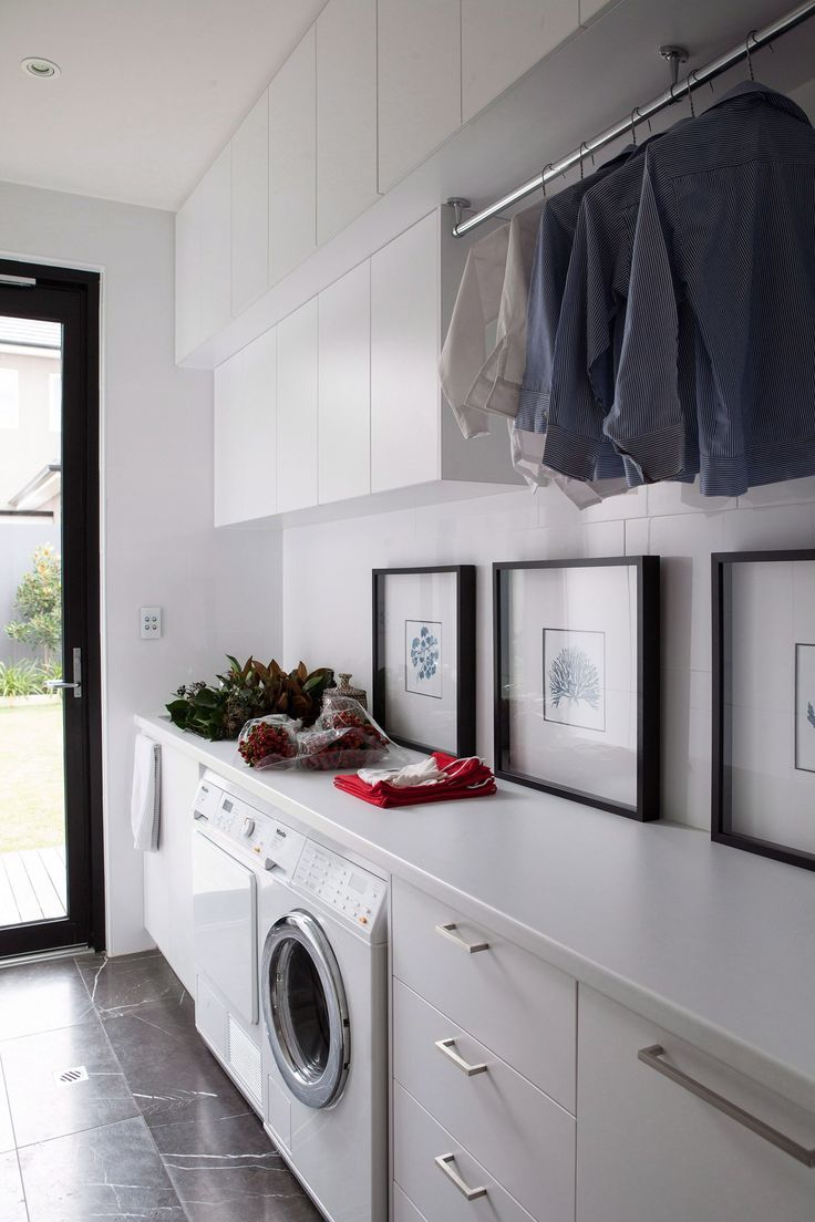 if you can afford to, use similar finishes in the laundry as you have in the bathrooms. Also, include some decorative touches. Suddenly, you have a cosy space that feels no different to the rest of the house. *Photo: Jared Fowler / bauersydndication.com.au*