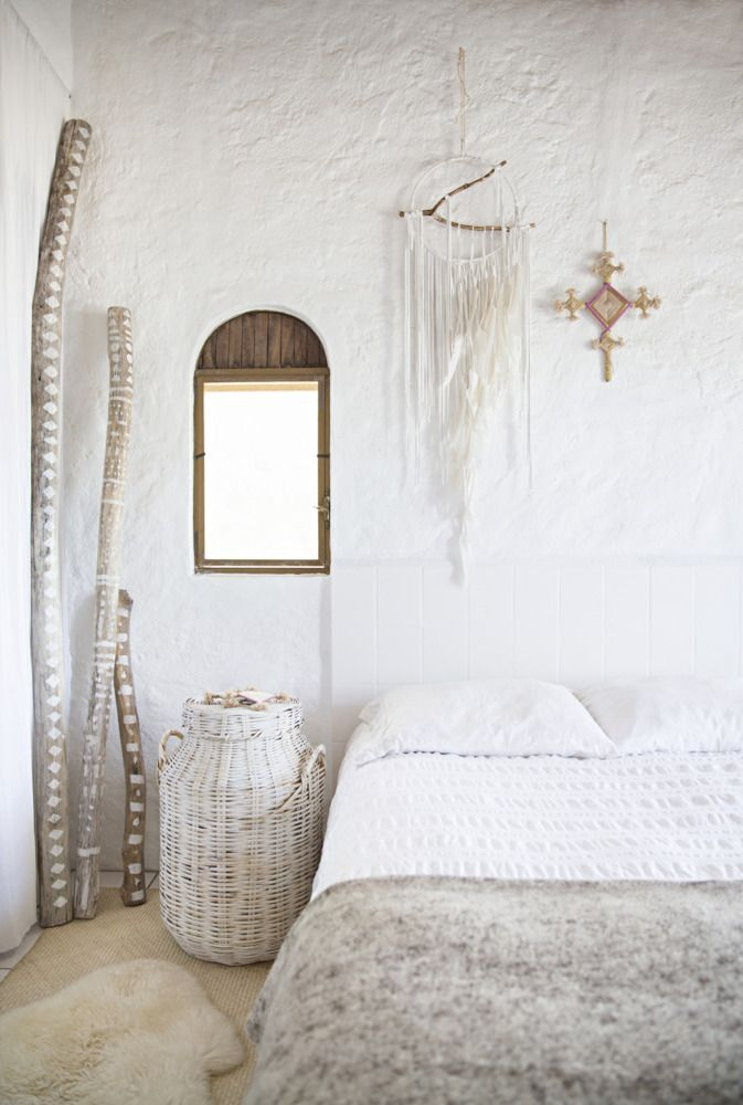 The dream catcher and wooden window treatment give this room a bohemian vibe. | http://domino.com