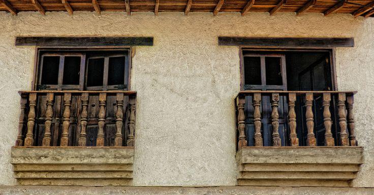 Balcones en las coloniales casas de Curití en Santander Colombia  Spanish Colonial Dual Balcony, Curití, Colombia by Adam Rainoff on 500px