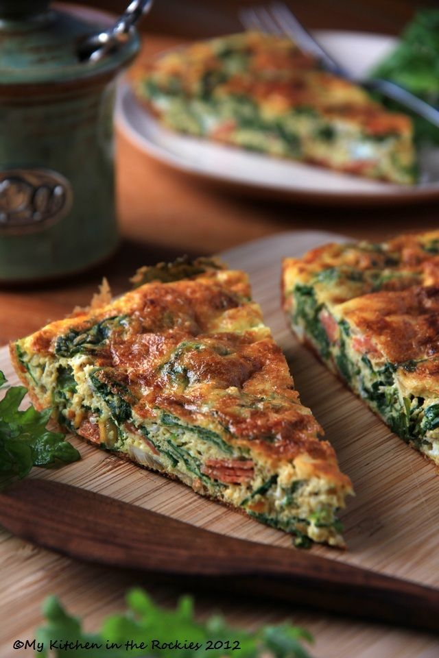 quiche, shredded zucchini and sweet potato, spinach, cheese and fresh tomato on top !