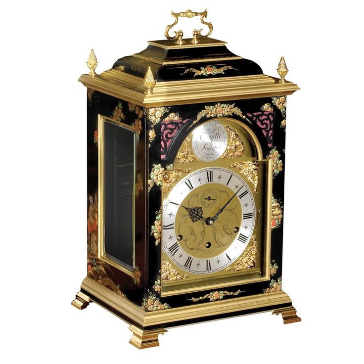 Chinoiserie -- Solid cherry, lacquered, burnished and individually handpainted. Each clock requires two weeks to complete the artwork alone: layer gesso, gold leaf and final decorative detail.  Finest quality triple chime nine nested movement with automatic chime sequence correction and night silencer. Solid brass dial has silvered chapter ring and cast brass spandrels. Beveled glasses fitted on all sides. All brassware is goldplated. Handmade in England exclusively for Scully & Scully in a…