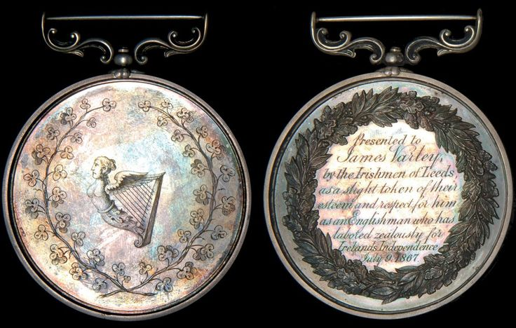 Ireland, Fenian Rising, 1867: An engraved silver presentation medal on a large struck flan, 65 mm, obv. Irish Harp within shamrock wreath, rev. [struck] oak and laurel wreath enclosing the inscription 'Presented to James Varley, by the Irishmen of Leeds, as a slight token of their esteem and respect for him as an Englishman who has labored zealously for Irelands Independence July 9, 1867' with swivelling scroll suspension, of high quality manufacture, virtually mint state