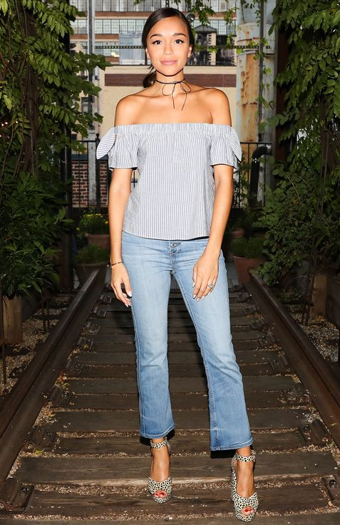 Ashley Madekwe in an off-the-shoulder striped top and kick flare jeans