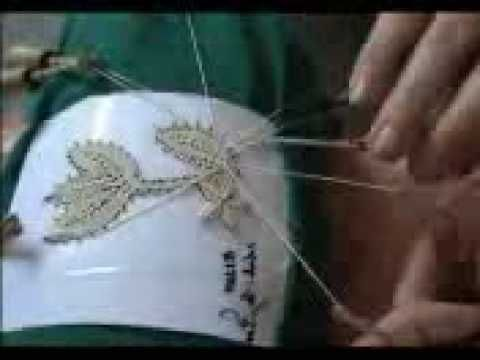 how to make bobbin lace. Very interesting demonstration.  Listen to the click of the bobbins.