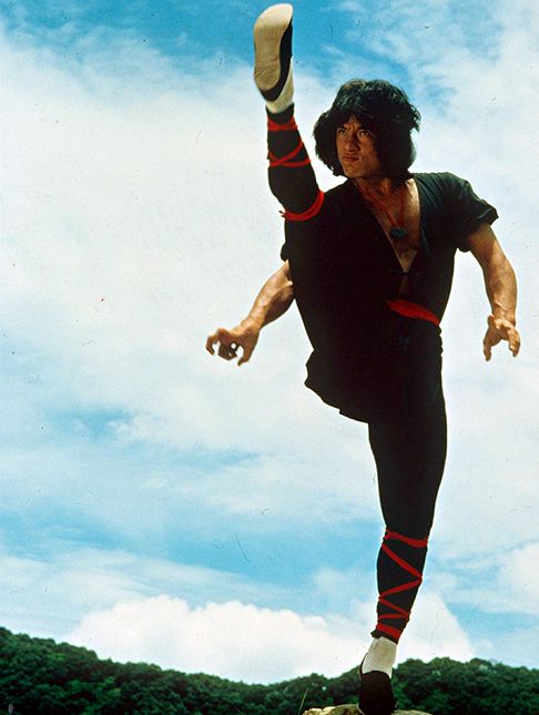 Jackie Chan performs a high kick in a publicity still for the 1982 film Dragon Lord