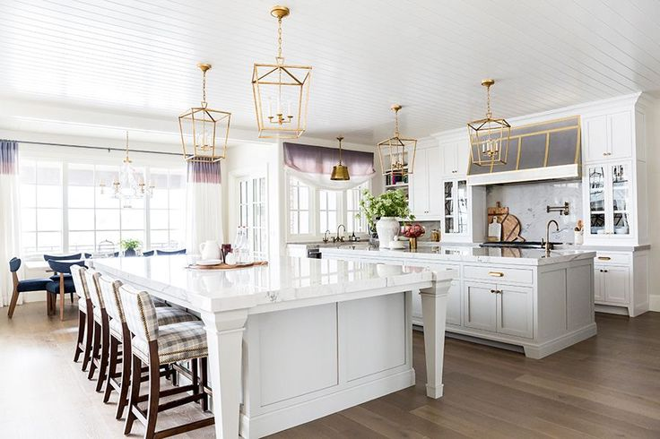 Ivory Lane KitchenThe hardware is from Pottery Barn and the countertops are by Macabus Quartzite from Italia Granite. The incredible pendant lights are from Visual Comfort. The paint colors, White Dove and Gray Mist, are both by Benjamin Moore