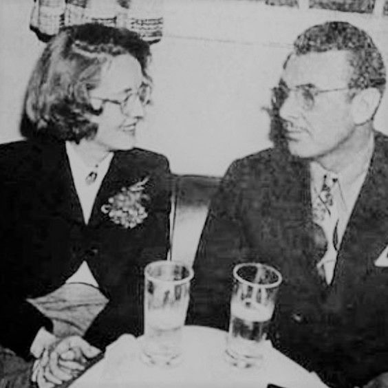 It's Bette! Wearing a wig (because she had shaved her hairline for The Private Lives of Elizabeth and Essex) on a date with George Brent. The two dated for about a year..