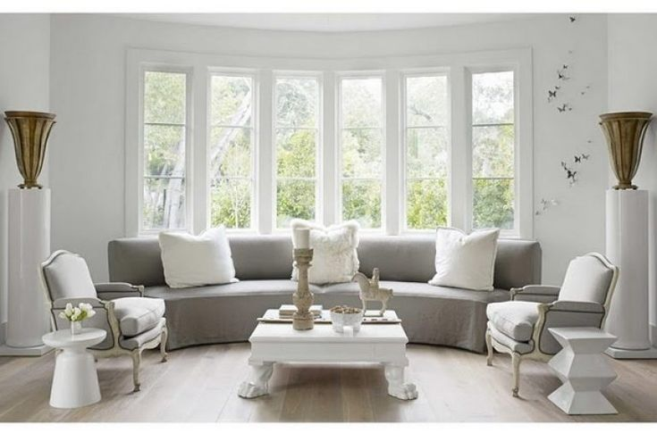 bay window ideas living room grey tone living room love the rounded couch in front of bay property reading room pinterest living room grey