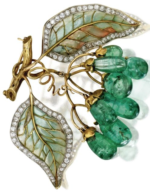 An Art Nouveau Gold, Emerald, Diamond, Plique-à-Jour Enamel Brooch, Marcus & Co., Circa 1900. The articulated cluster of grapes set with emeralds drops, suspended from a branch supporting leaves set with old European-cut diamonds, applied with green and light pink plique-à-jour enamel