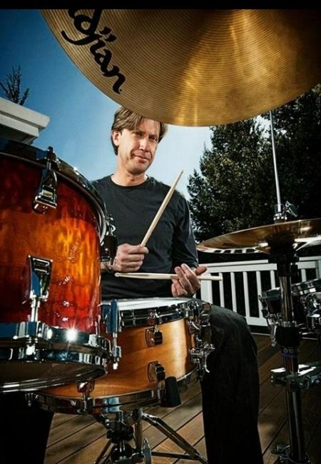 Featured drummer, Tommy Igoe.