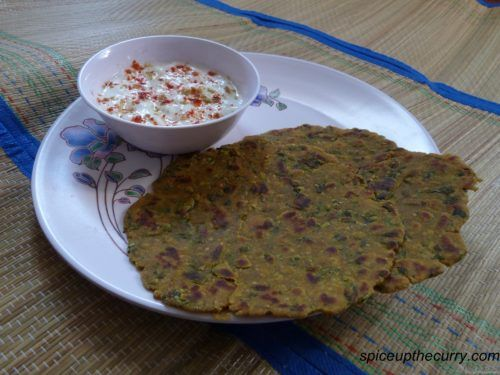 This is perfect tea time snack from state of Gujarat. You can serve it with pickle or chutney. But I like to eat this with yogurt.Because of millet flour (bajra flour) it will not be perfect round, you will get rough edges unlike roti or paratha.