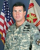 Lieutenant Commander Ronald Johnson in the Army Combat Uniform--discussion of different uniforms