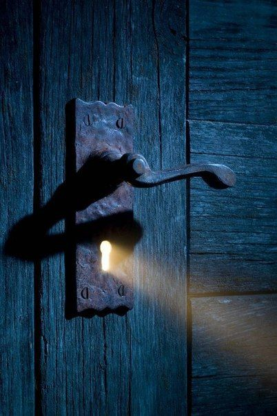 Writing prompt: You come upon this door in an abandoned old house in the woods. You notice a light coming from the keyhole…when you look in…...