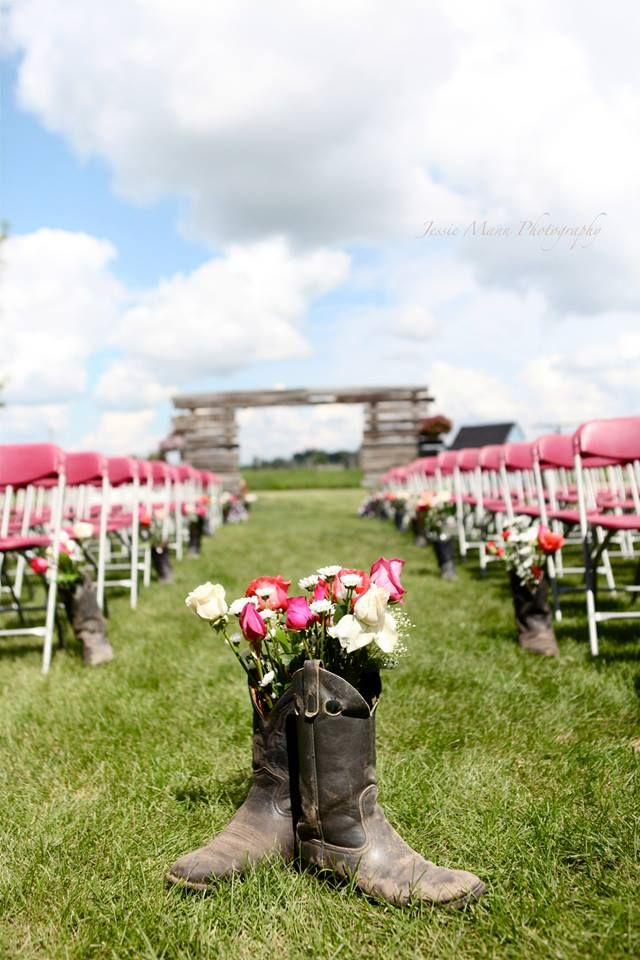 Dad's cowboy boots lined the aisle <3, walking Mom and I up it. - Jessie Mann Photography