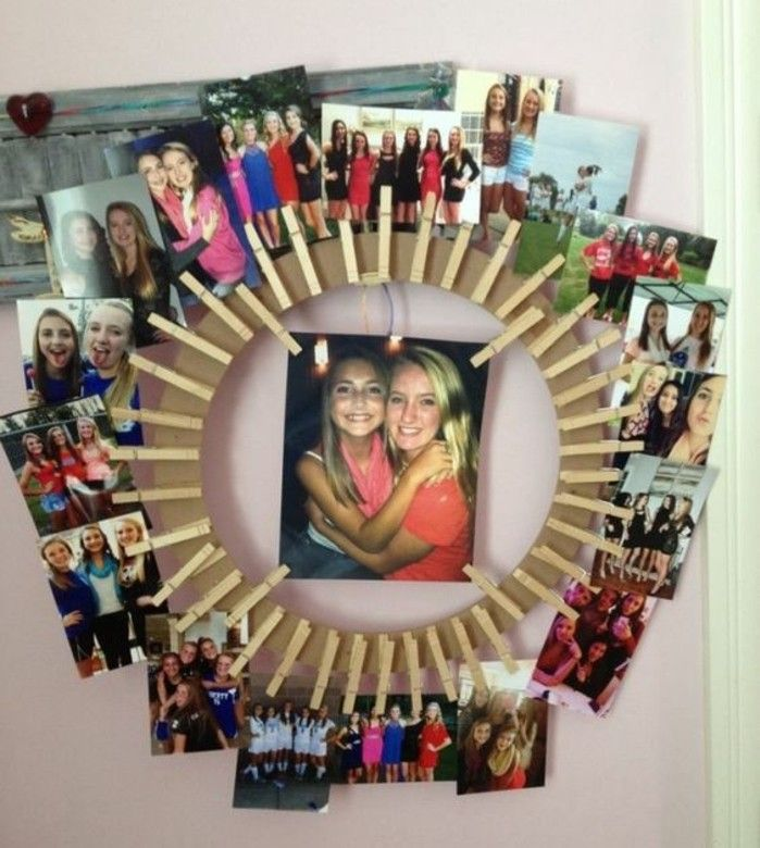 cool gifts for teens, cardboard wheel decorated with photos, showing smiling teenage girls, attached to it with wooden clips