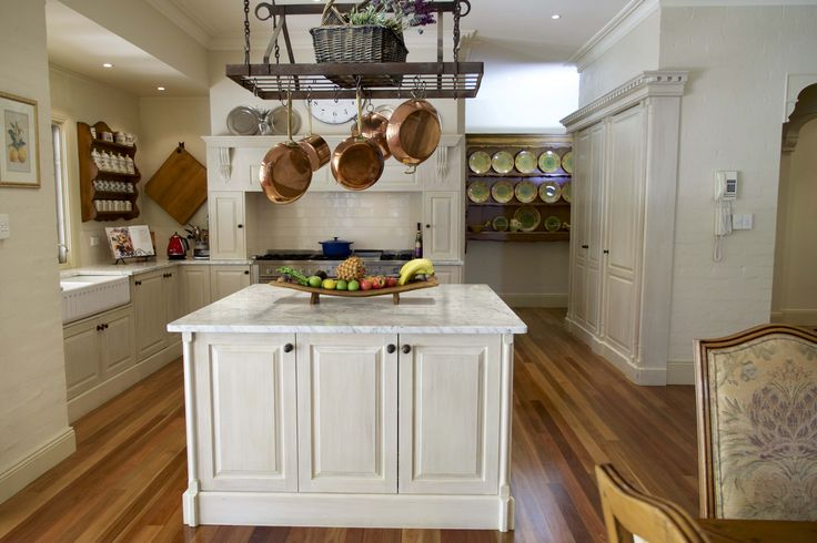 The kitchen island unit is a great feature in this kitchen - French provincial style in Sydney, Australia