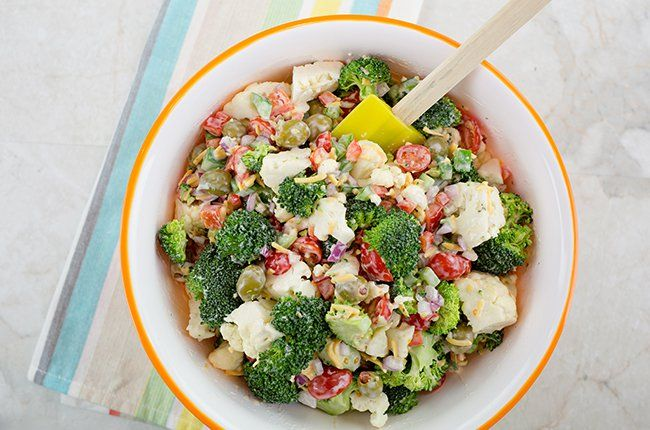 Broccoli Salad:  2 heads broccoli, cut into small florets 1 head cauliflower, cut into small florets 1 red bell pepper, diced 1 green bell pepper, diced ½ small red onion, diced ¾ cup reduced-salt green olives 2 cups grape tomatoes, halved 1 cup shredded reduced-fat sharp cheddar cheese (I like Sargento®) 1 cup Bolthouse Farms® Classic Ranch Yogurt Dressing