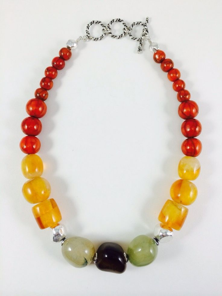 Hand made necklace is made of semiprecious stones agate beads ,silver plated beads and acrylic bead. Price - 25$