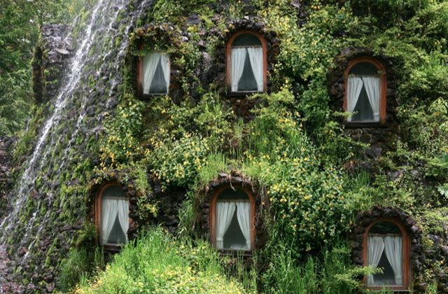 Montaña Mágica Lodge, also known as Magic Mountain Lodge, is located within Huilo Huilo, a 232 square mile natural reserve in southern Chile. Covered in rainforest moss and vines, this manmade volcano-like structure spews water and is only accessible by a monkey bridge. And if this isn't sufficiently magical and surreal, outside are hot tubs, carved from hollowed out tree trunks, with ideal vantage points for wildlife sightings. Honestly? WTF.