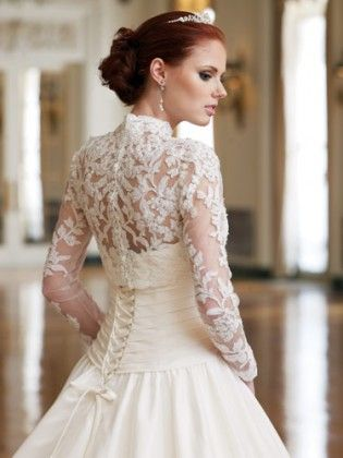 This is the sort of wedding dress that I want for myself. I adore the lace detail all over the back and sleeves, all pulled in with a corset...