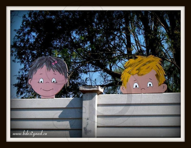 Wooden characters peeping over a preschool wall