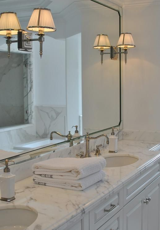 Chic Master Bathroom Boasts A White Custom Dual Vanity Paired With Gray And Marble Countertops