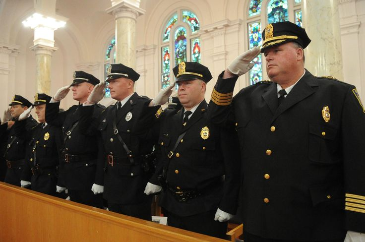 Brockton police chief John Crowley, right, during the annual Saint Patrick's Day & Public Safety Mass on Saturday, March 11, 2017 at Saint Patrick's Church in Brockton.    (Marc Vasconcellos/The Enterprise)