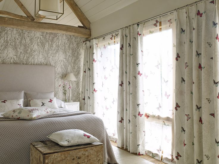 Sanderson Fabric - Butterfly Voile (225512)  Jewel-like butterflies flit delicately across this exquisite sheer linen fabric. Paired here with curtains of opaque linen featuring 'Wisteria & Butterfly'