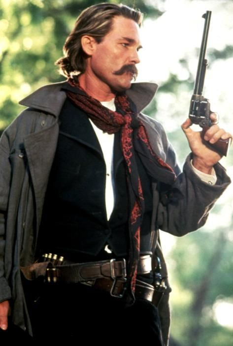 Kurt Russell - Tombstone  I love this movie! (Trench coat mafia cowboys, with their long mustache's).