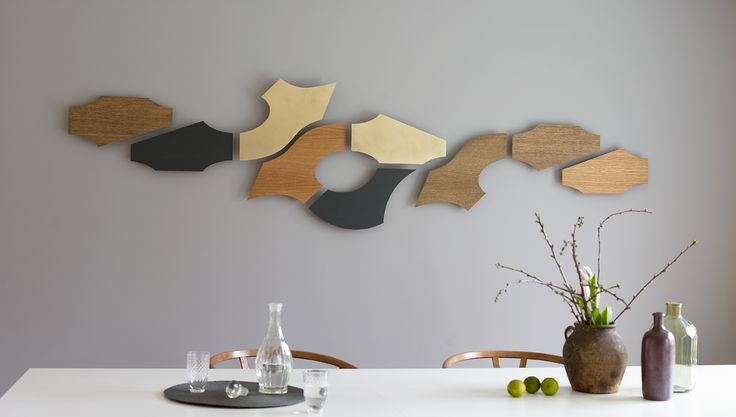 Enjoy your dinner with a view to this wall sculpture that is a mixture of XOX, Yin and Zeppelin in oak, zinc and brass.