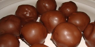 CHOCOLATE COVERED RICE KRISPIE PEANUT BUTTER BALLS - Looks like I will be making these for Christmas!