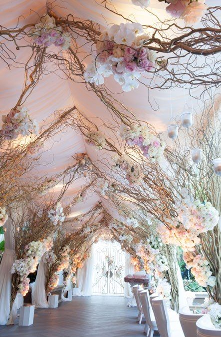 A walkway of whimsical branches and blooms was out of a fairytale at this @Mandy Bryant Dewey Seasons Hotel Los Angeles at Beverly Hills wedding.