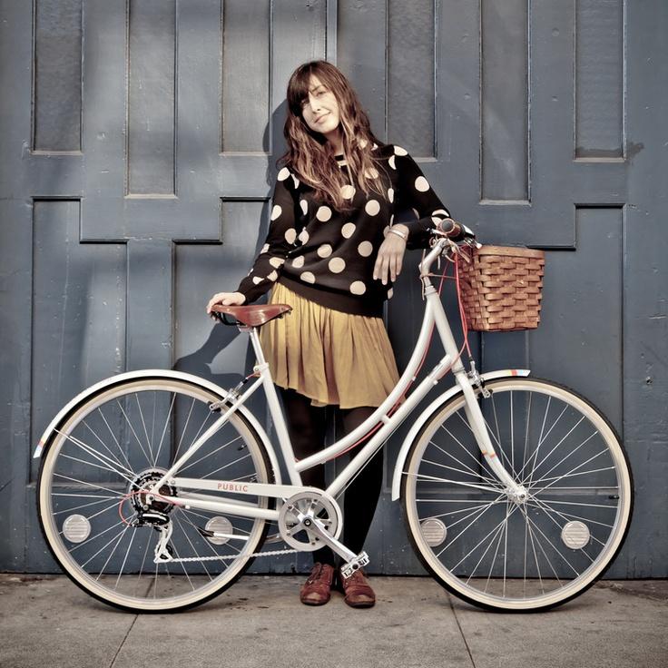 Cute polka dot sweater and a beautiful white bike
