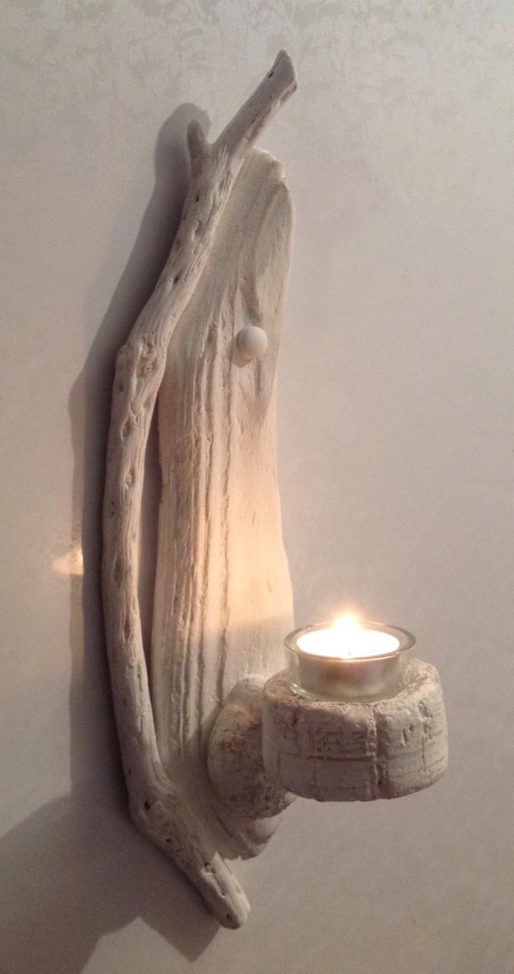 Driftwood wall sconce gorgeous sculpted driftwood wall for Kitchen cabinets lowes with seashell wall art craft