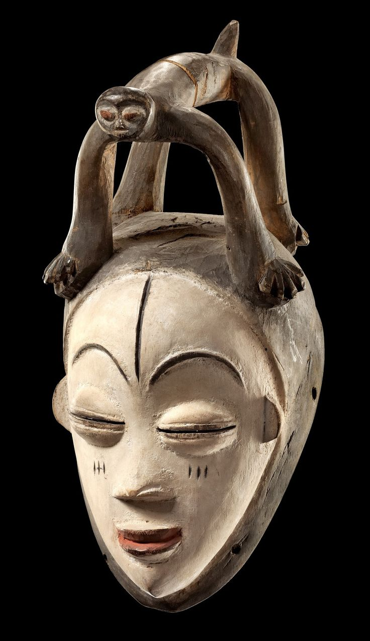 """Africa   Mask """"okuyi"""" from the Punu people of Gabon   Woo, kaolin, red and black paint   Variation of the """"white masks of the Ogowe"""". Originally used at funerary ceremonies, embodying male and female ancestors. The mask dancers wore costumes of raffia or cotton weave, while walking on high stilts and threatening the audience with wild screams."""