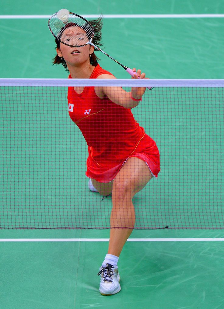 Sayaka Sato of Japan in action during her Women's Singles Badminton match against Susan Egelstaff of Great Britain on Day 4 of the London 2012 Olympic Games at Wembley Arena on July 31, 2012 in London, England.