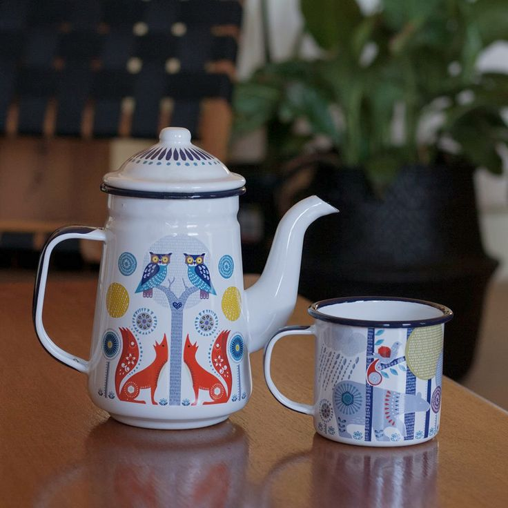 Dont you just adore this folklore enamel coffee pot and