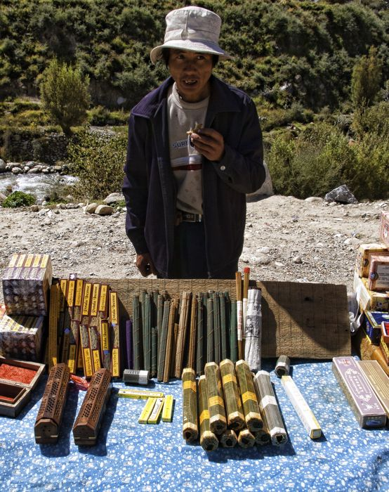 A vendor sells handmade Tibetan incense along the highway west of Lhasa. The highways leads to Shigatse, and then on to Tingri, where you turn off onto a small gravel road to reach Mt Everest. From Tingri it travels on to the border with Nepal.