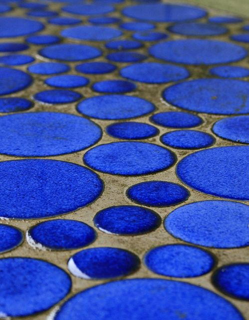 The repetition of the blue circles is a great pattern because the elements are able to be expressed and they capture attention