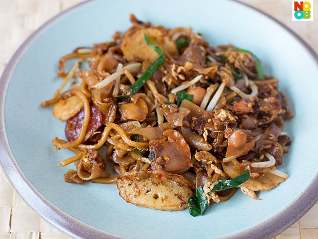 Recipe for char kway teow (stir fried flat rice noodles with cockles, fish cake and lup cheong), a popular Singapore hawker dish.