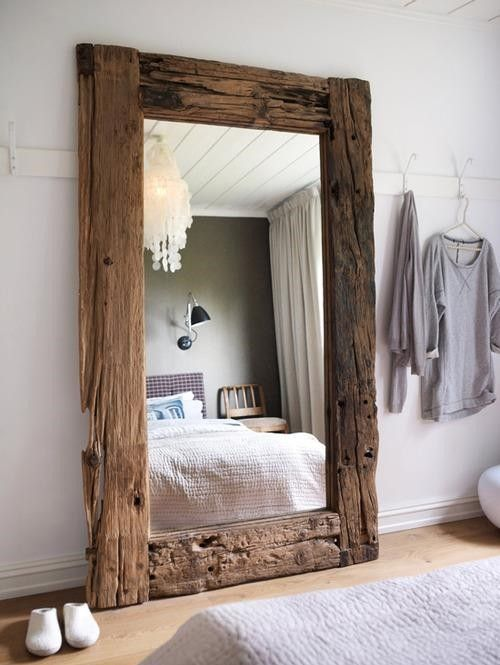rustic wooden mirror and gorgeous white chandelier