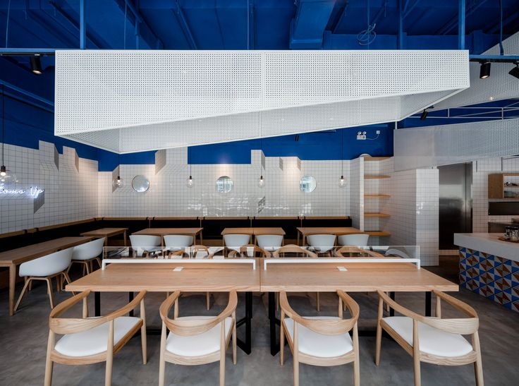 swimming pool studio aimed to bring the relaxing and refreshing hues of blue sea - Blue Restaurant Design